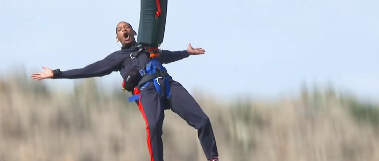 WATCH: Will Smith bungee jumps out of a helicopter