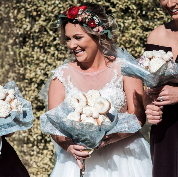 FORGET FLOWER BOUQUETS...THIS BRIDE GETS MARRIED WITH A BOUQUET OF DONUTS INSTEAD!