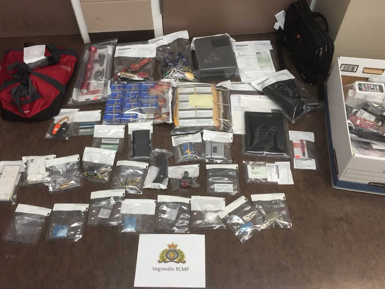 THREE PEOPLE CHARGED AFTER A TON OF STOLEN PROPERTY IS FOUND IN A CAMPER VAN NEAR VEGREVILLE