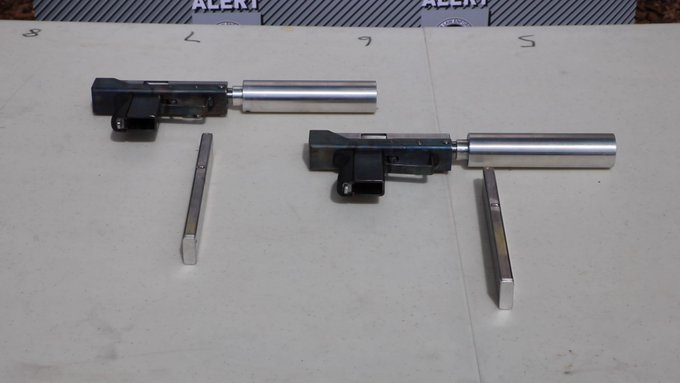 TWO PEOPLE CHARGED AFTER SUBMACHINE GUNS ARE ALLEGEDLY MADE WEST OF EDMONTON