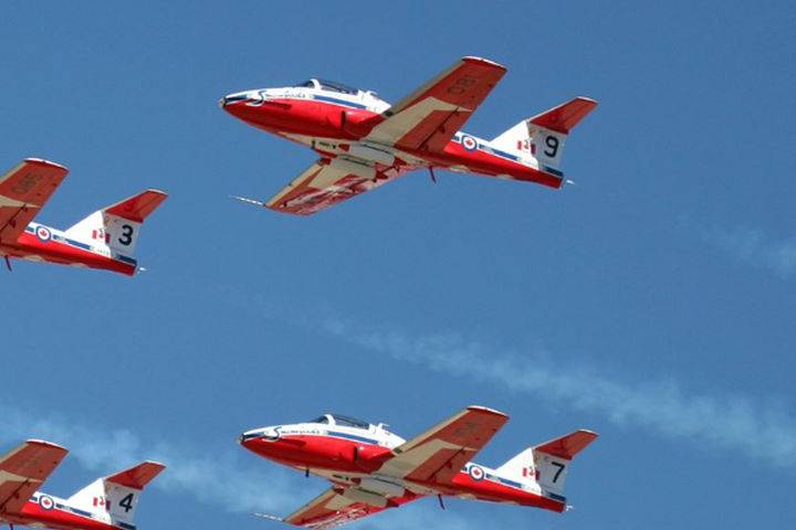 SNOWBIRDS DOING A FLYBY OVER EDMONTON THIS AFTERNOON