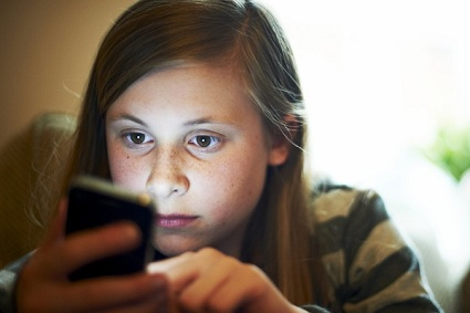 NEW STUDY SAYS TEENS WHO SPEND A LOT OF TIME ON THEIR SMARTPHONES---ARE MORE UNHAPPY