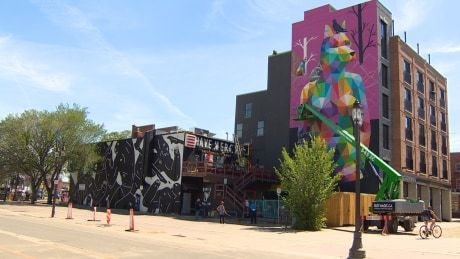 SPANISH STREET ARTIST PAINTS MASSIVE MURAL IN OLD STRATHCONA