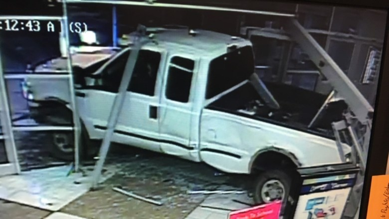 CROOKS DRIVE TRUCK INTO RED DEER MALL AND TAKE OFF WITH TWO ATM'S