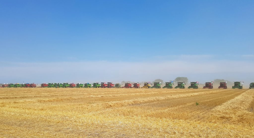 HARVEST FOR KIDS SETS WORLD RECORD FOR MOST COMBINES HARVESTING IN A FIELD AT ONCE