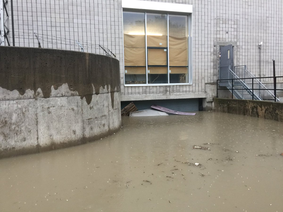 MEN RESCUED FROM ELEVATOR FLOODED BY HEAVY DOWNPOURS IN TORONTO