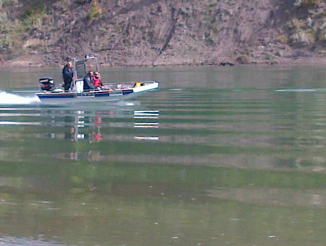 POLICE AND OTHER GROUPS SWEEPING THE SHORES OF THE NORTH SASKATCHEWAN RIVER THIS WEEK
