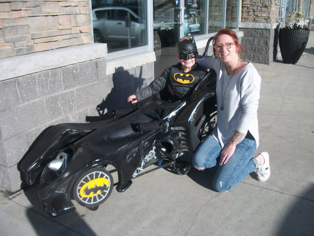 SPRUCE GROVE BOY GOING AS BATMAN FOR HALLOWEEN--THANKS TO HIS BEAUTIFUL BARBER