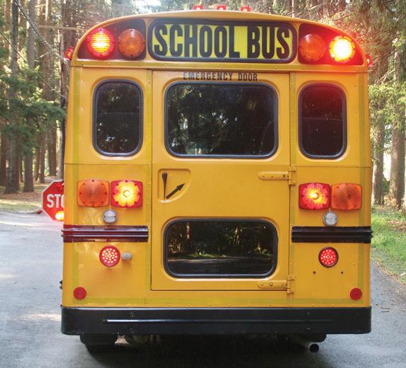 SHOULD SEAT BELTS BE MANDATORY ON SCHOOL BUSES?