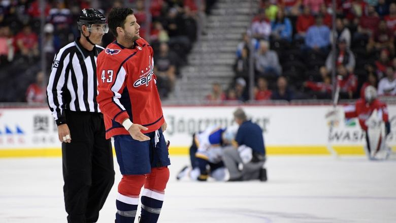 CAPS' FORWARD TOM WILSON BANNED FOR 20 GAMES FOR HIT ON BLUES PLAYER