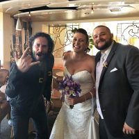Keanu Reeves Poses With Newly Weds